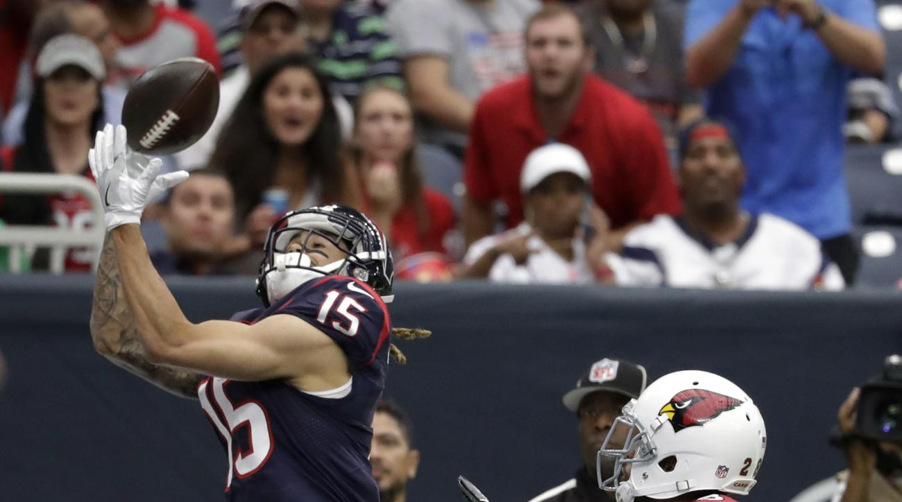 Houston Texans wide receiver Will Fuller (15) makes a catch for a touchdown as Arizona Cardinals cornerback Brandon Williams (26) defends the play during the first half of an NFL preseason football game, Sunday, Aug. 28, 2016, in Houston. (AP Photo/Jeff R