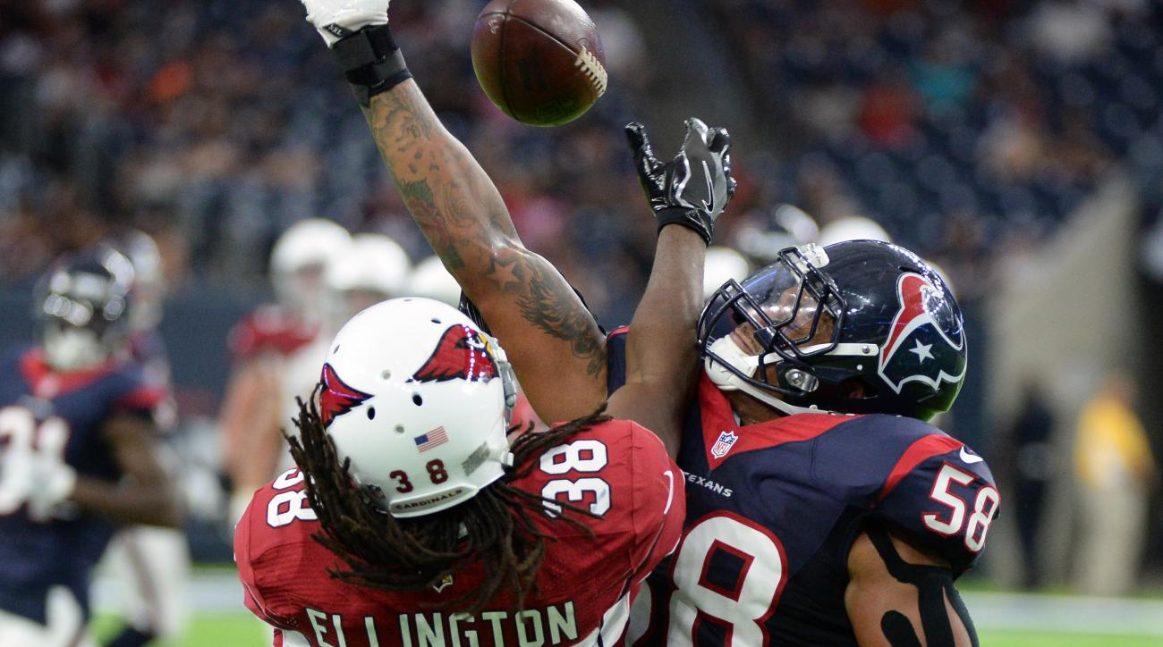 Houston Texans outside linebacker Reshard Cliett (58) breaks up a pass intended for Arizona Cardinals running back Andre Ellington (38) during the second half of an NFL preseason football game, Sunday, Aug. 28, 2016, in Houston. (AP Photo/George Bridges)
