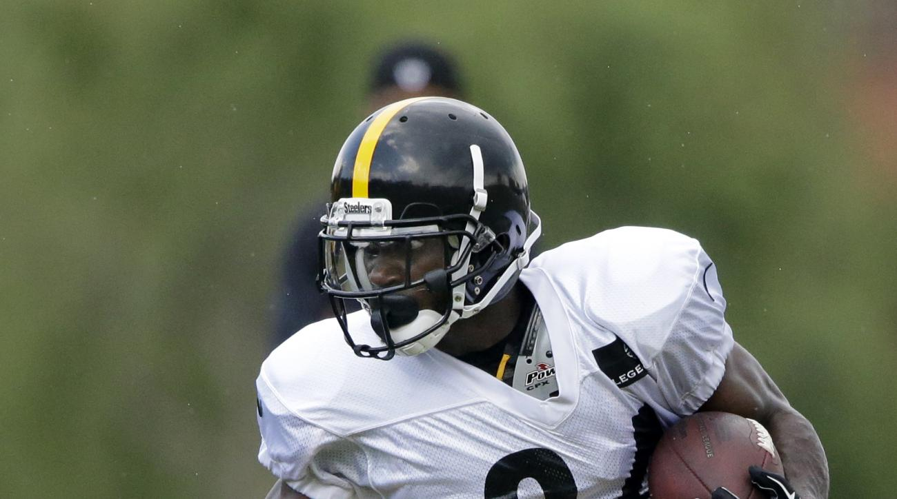 FILE - In this Aug. 1, 2016, file photo, Pittsburgh Steelers wide receiver Antonio Brown (84) runs after making a catch during a practice at the NFL football team's training camp in Latrobe, Pa. The rancorous rivalry between the Steelers and Bengals will