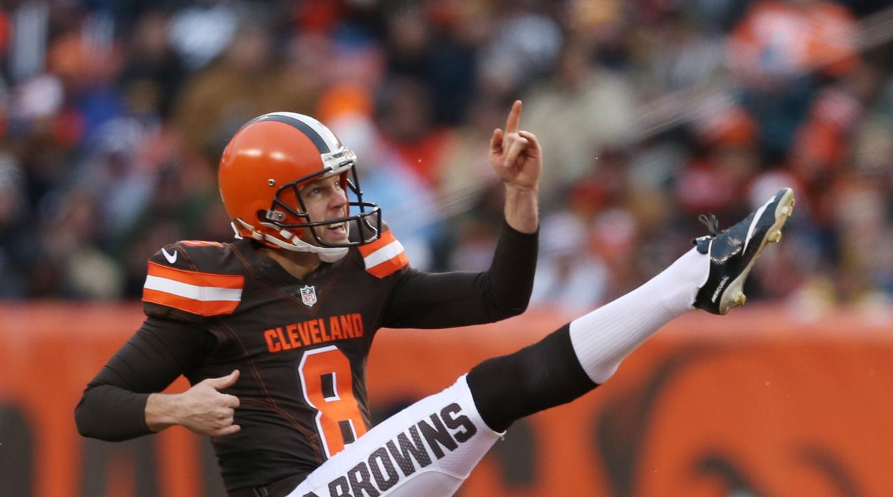 This  Jan. 3, 2016 photo shows Cleveland Browns punter Andy Lee (8) kicking against the Pittsburgh Steelers during the first half of an NFL football game in Cleveland. The Cleveland Browns have traded Lee to Carolina for punter Kasey Redfern and a 2018 fo