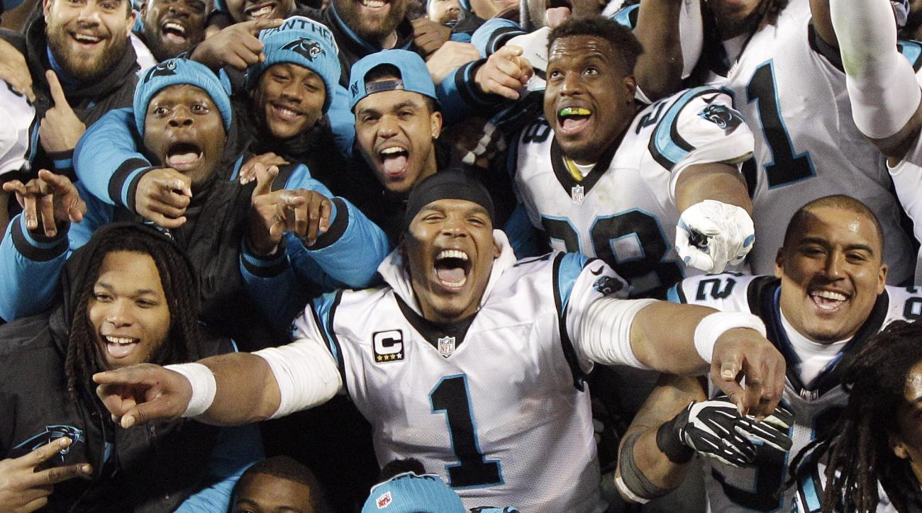 FILE - In this Jan. 24, 2016, file photo, Carolina Panthers' Cam Newton celebrates with teammates during the second half the NFL football NFC Championship game against the Arizona Cardinals in Charlotte, N.C. For the first time since the NFL created its c