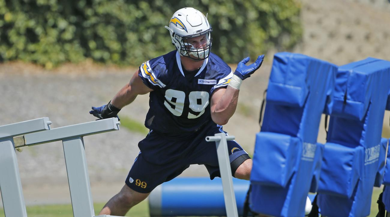 San Diego Chargers NFL football player Joey Bosa works out at his first practice since agreeing to a four year contract,  Tuesday, Aug. 30, 2016, in San Diego. (AP Photo/Lenny Ignelzi)