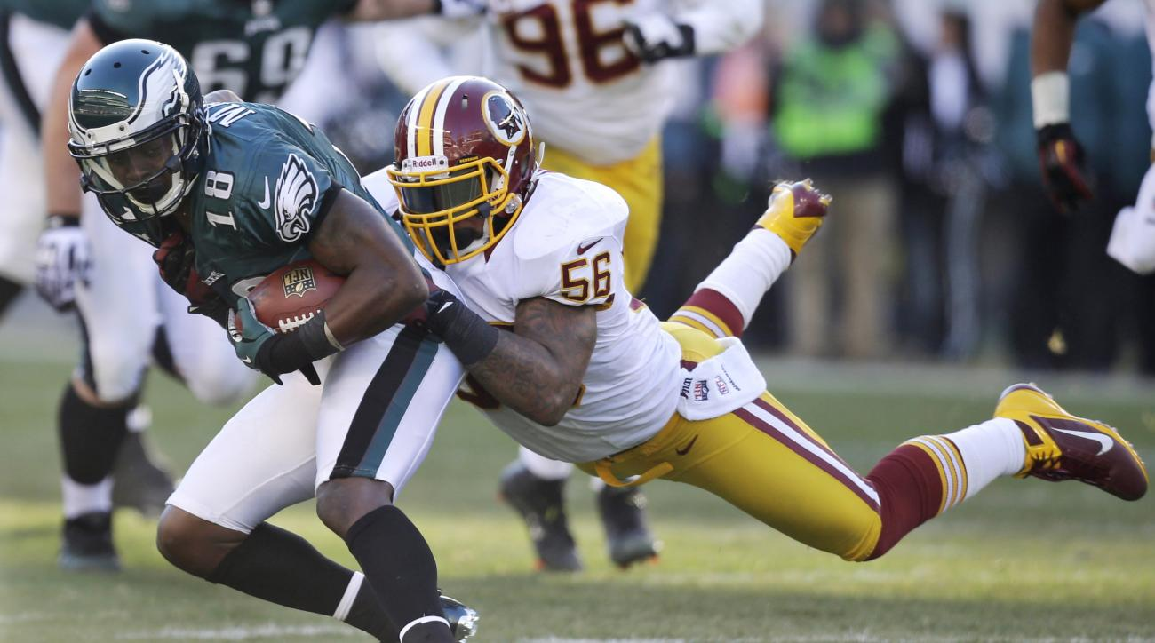 FILE - In this Sunday, Dec. 23, 2012 file photo, Philadelphia Eagles' Jeremy Maclin, left, is tackled by Washington Redskins' Perry Riley in the first half of an NFL football game in Philadelphia. The Washington Redskins released four-year starting lineba