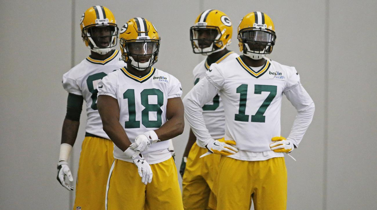 FILE - In this Monday, June 6, 2016 file photo, Green Bay Packers wide receiver Randall Cobb (18) and wide receiver Davante Adams (17) participate in drills during an NFL football practice in Green Bay, Wis. Its a toss-up at receiver for the Green Bay Pac