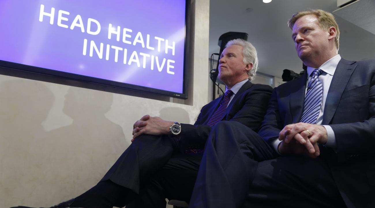 FILE - In this March 11, 2013, file photo, Chairman and CEO of General Electric, Jeff Immelt, left, and NFL Commissioner Roger Goodell listen during a news conference in New York, about GE partnering with the NFL, the US Military, and others to further re