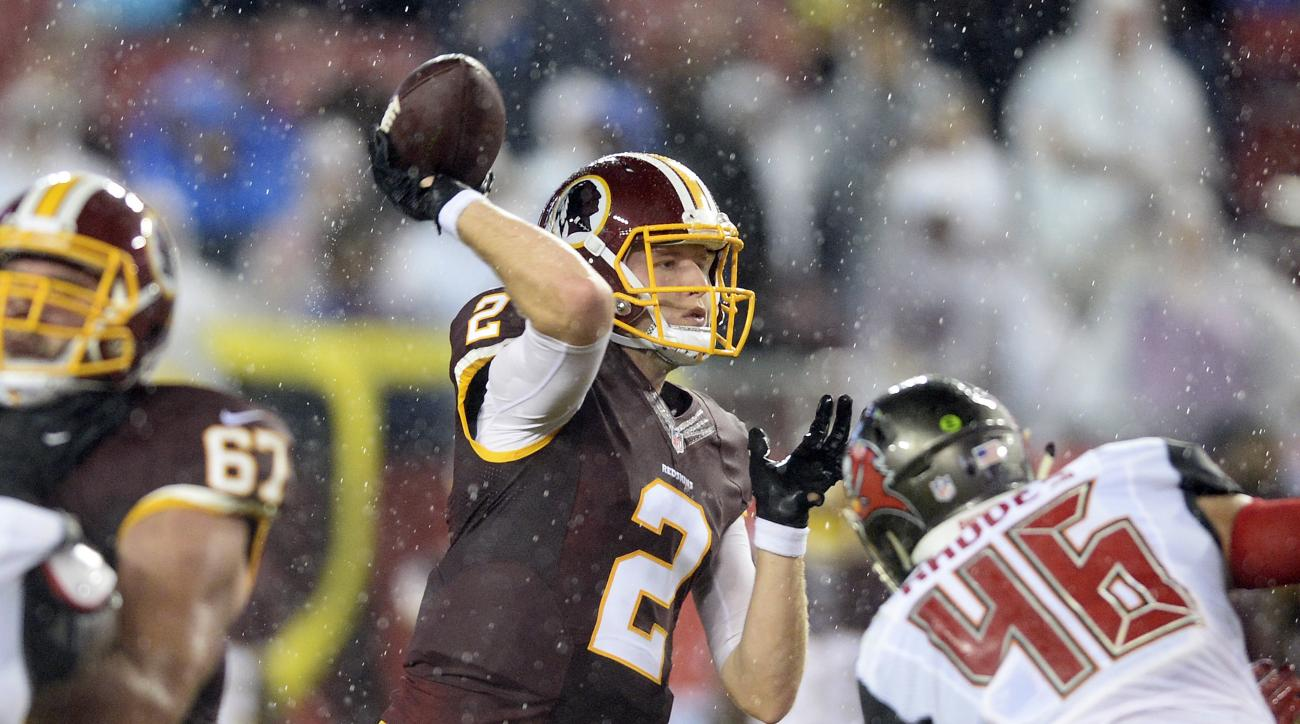 Washington Redskins quarterback Nate Sudfeld (2) throws a pass as he is pressured by Tampa Bay Buccaneers linebacker Luke Rhodes (46) during the first quarter of an NFL preseason football game Wednesday, Aug. 31, 2016, in Tampa, Fla. (AP Photo/Jason Behnk