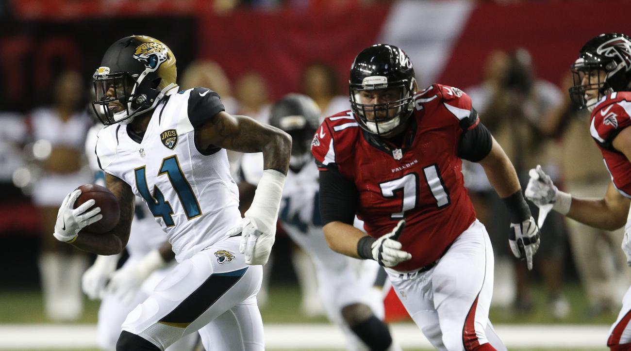 Jacksonville Jaguars cornerback Nick Marshall (41) runs past Atlanta Falcons offensive guard Wes Schweitzer (71) during the first half of a preseason NFL football game, Thursday, Sept. 1, 2016, in Atlanta. (AP Photo/John Bazemore)