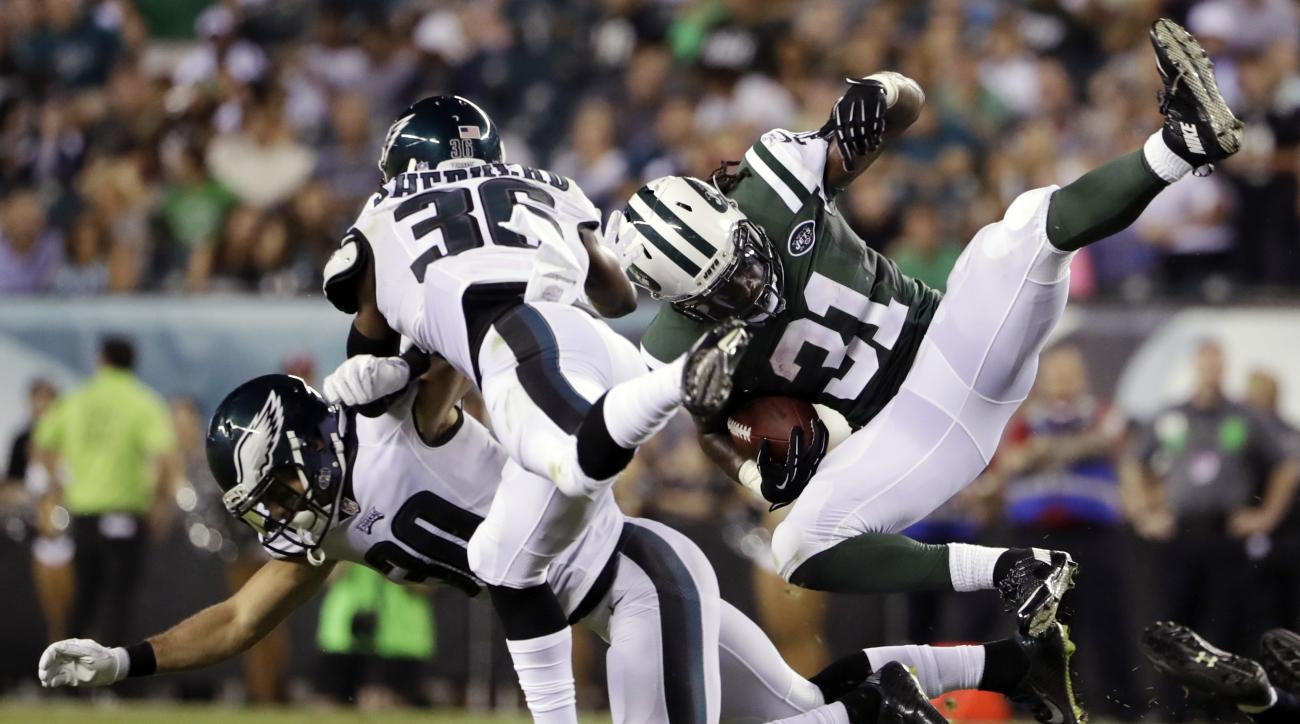 New York Jets' Khiry Robinson (31) is tackled by Philadelphia Eagles' JaCorey Shepherd (36) and Ed Reynolds (30) during the first half of a preseason NFL football game, Thursday, Sept. 1, 2016, in Philadelphia. (AP Photo/Matt Rourke)