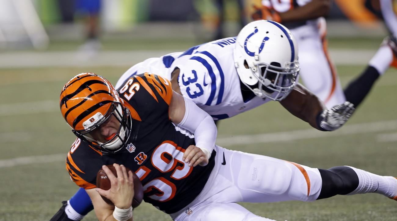Cincinnati Bengals inside linebacker Nick Vigil (59) is tackled by Indianapolis Colts running back Robert Turbin (33) after making an interception during the first half of an NFL football game in Cincinnati, Thursday, Sept. 1, 2016. (AP Photo/Frank Victor