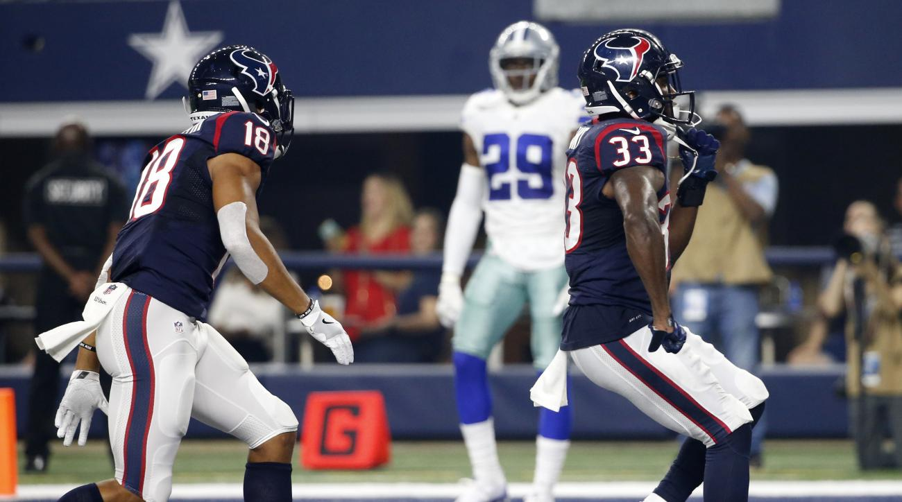 Houston Texans' Cecil Shorts (18) and Dallas Cowboys' Deji Olatoye (29) watch as the Texan's Akeem Hunt (33) celebrates his touchdown run in the first half of a preseason NFL football game, Thursday Sept. 1, 2016, in Arlington, Texas. (AP Photo/Michael Ai