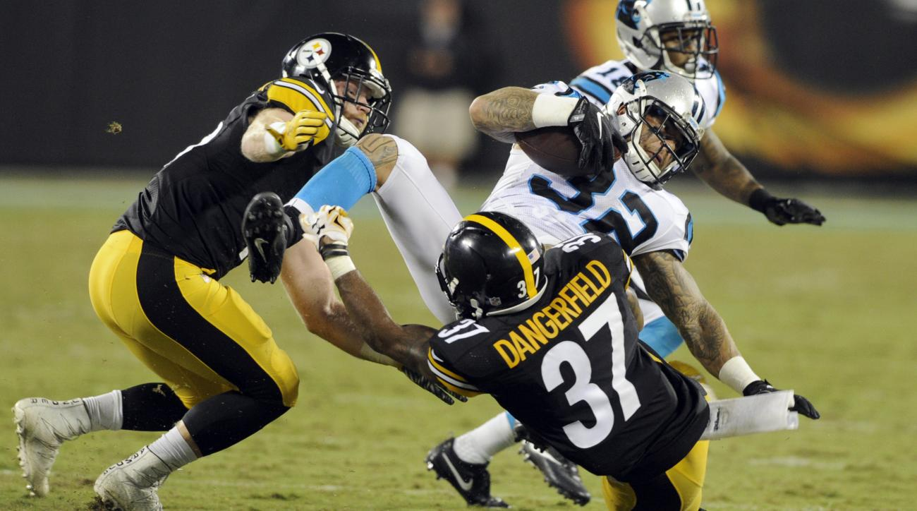 Carolina Panthers' Brandon Wegher (32) is tackled by Pittsburgh Steelers' Jordan Dangerfield (37) in the second half of a preseason NFL football game in Charlotte, N.C., Thursday, Sept. 1, 2016. (AP Photo/Mike McCarn)