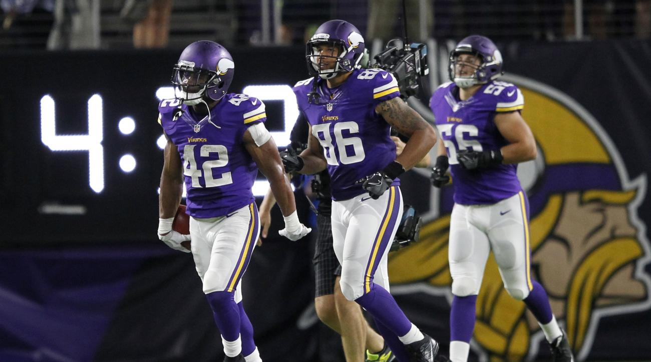 Minnesota Vikings running back Jhurrell Pressley (42) celebrates after returning a kickoff for a touchdown during the second half of an NFL preseason football game against the Los Angeles Rams, Thursday, Sept. 1, 2016, in Minneapolis. (AP Photo/Andy Clayt