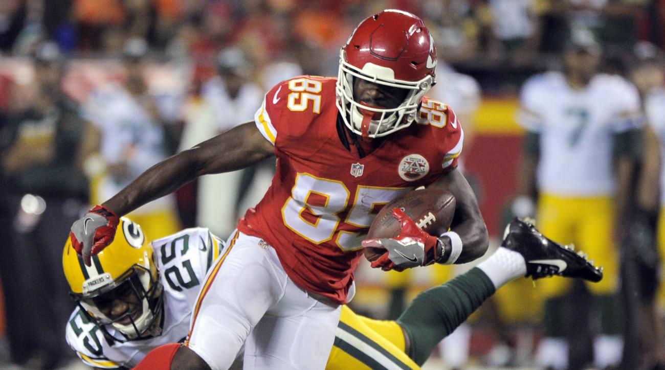 Kansas City Chiefs wide receiver Frankie Hammond (85) runs away from a tacke attempt by Green Bay Packers safety Marwin Evans (25) during the second half of an NFL preseason football game in Kansas City, Mo., Thursday, Sept. 1, 2016. (AP Photo/Ed Zurga)