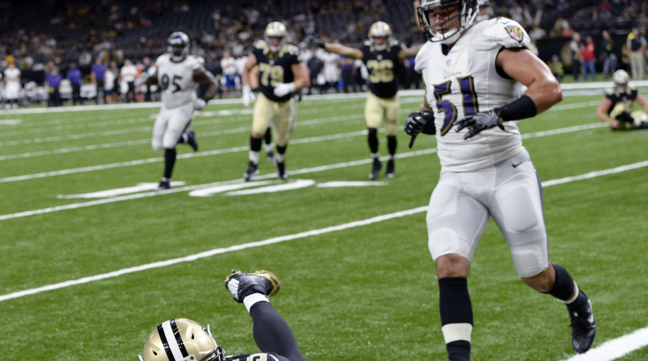 New Orleans Saints fullback Austin Johnson (35) dives over the pylon for a touchdown in the second half of a pre-season NFL football game against the Baltimore Ravens in New Orleans, Thursday, Sept. 1, 2016. (AP Photo/Bill Feig)
