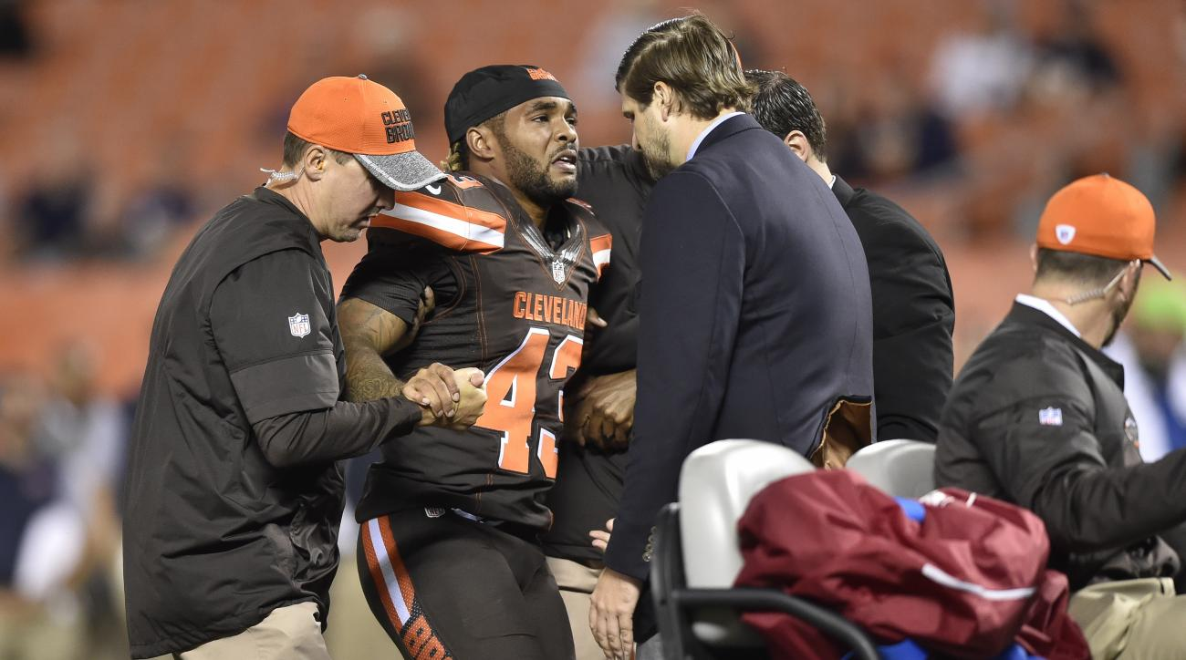 Cleveland Browns running back Rajion Neal (43) is helped off the field after an injury during the second half of an NFL preseason football game against the Chicago Bears, Thursday, Sept. 1, 2016, in Cleveland. (AP Photo/David Richard)
