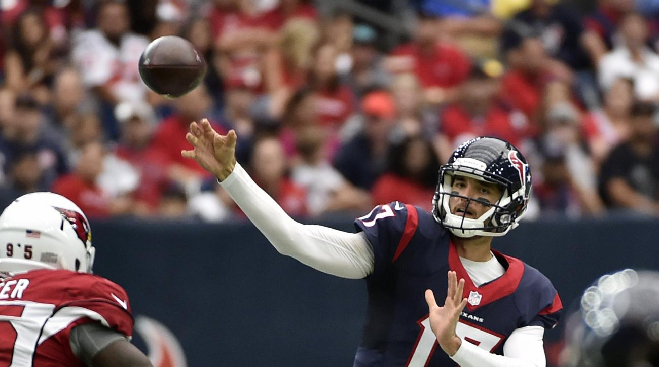 FILE - In this Aug. 28, 2016, file photo, Houston Texans quarterback Brock Osweiler (17) passes against the Arizona Cardinals during the first half of an NFL preseason football game in Houston. Osweiler is comfortable in Houston and ready to show the Texa