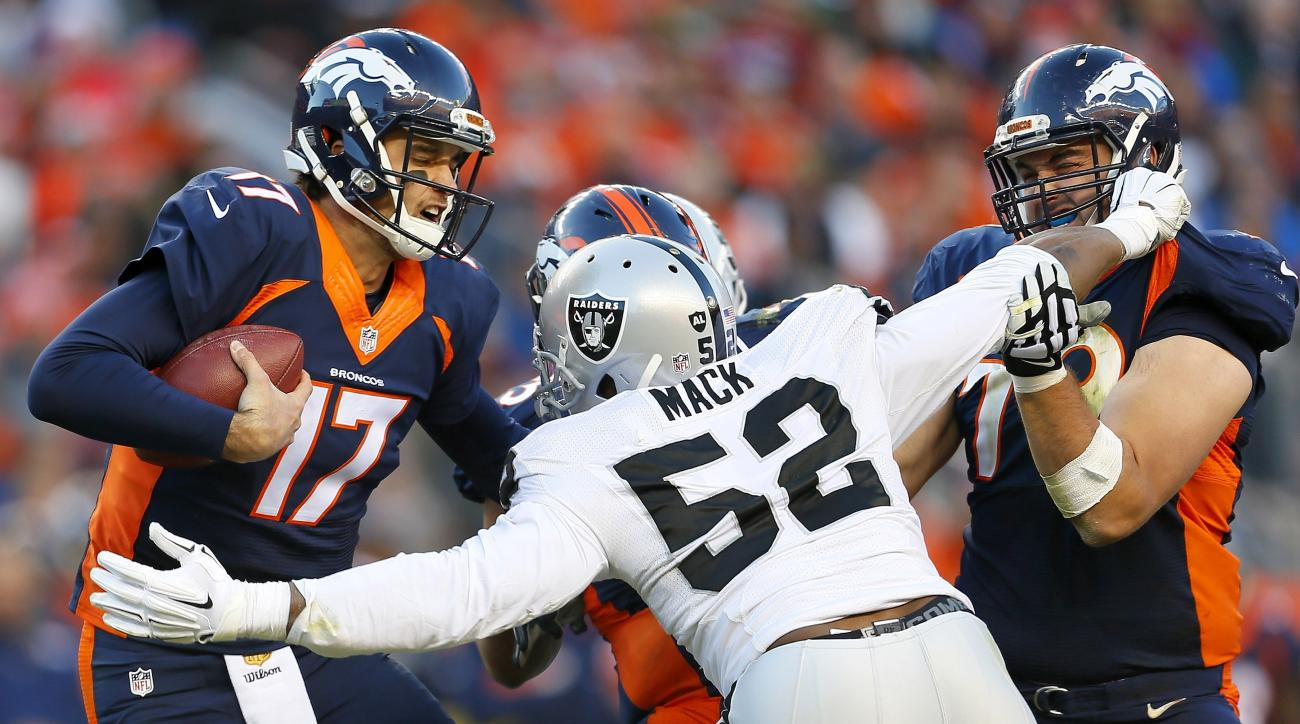 FILE - In this Dec. 13, 2015, file photo, Denver Broncos quarterback Brock Osweiler (17) is sacked by Oakland Raiders defensive end Khalil Mack (52) during the second half of an NFL football game in Denver. Soon after Derek Carr and Khalil Mack were draft
