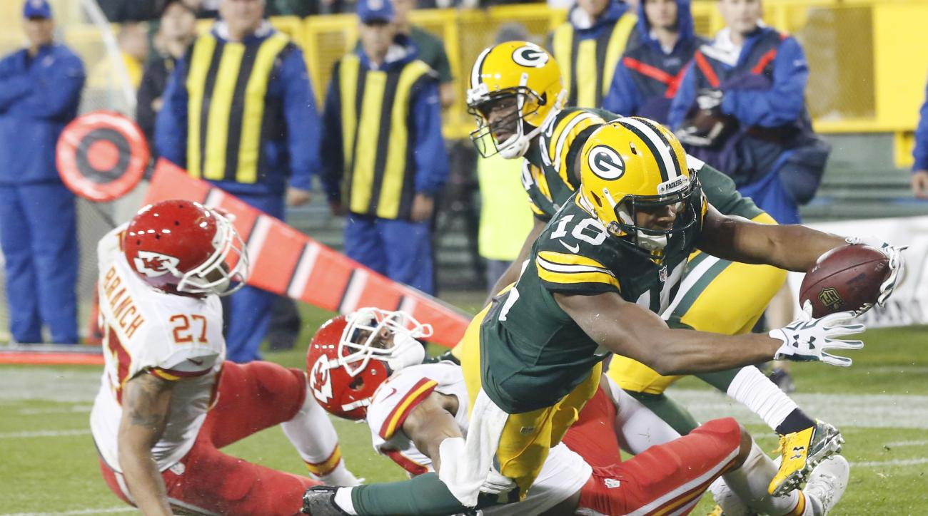 FILE - In this Sept. 28, 2015, file photo, Green Bay Packers' Randall Cobb dives into the end zone for a touchdown catch during the second half of an NFL football game against the Kansas City Chiefs, in Green Bay, Wis. Randall Cobb bulked up. Eddie Lacy s