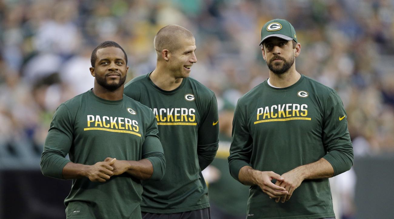 FILE - In this Aug. 12, 2016, file photo, Green Bay Packers quarterback Aaron Rodgers, right, wide receiver Jordy Nelson, center and wide receiver Randall Cobb stand on the sideline before an NFL preseason football game against the Cleveland Browns in Gre