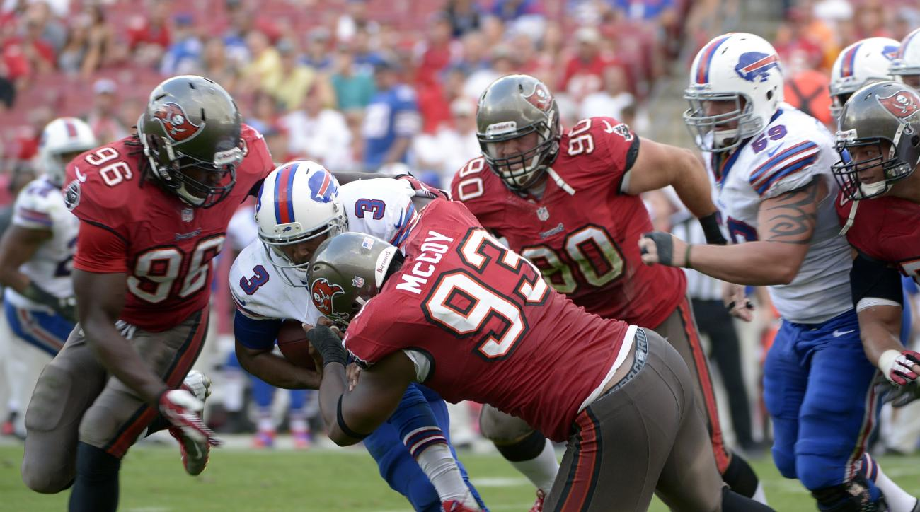 FILE - In this Dec 8, 2013, file photo, Buffalo Bills quarterback EJ Manuel (3) is sacked by Tampa Bay Buccaneers defensive tackle Gerald McCoy (93) as defensive end Steven Means (96) and defensive tackle Derek Landri (90) help during the second half of a