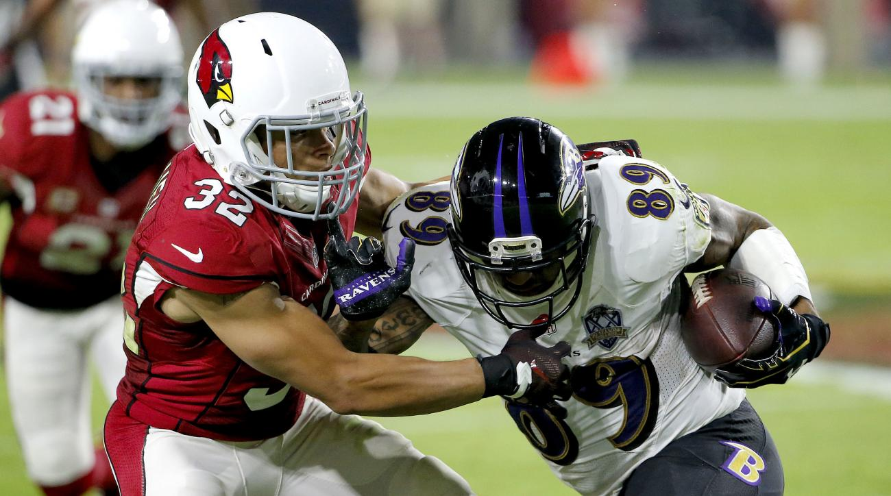 FILE - In this Oct. 26, 2015, file photo, Baltimore Ravens wide receiver Steve Smith (89) is stopped by Arizona Cardinals free safety Tyrann Mathieu (32) during the second half of an NFL football game in Glendale, Ariz. This is a team that knows its good