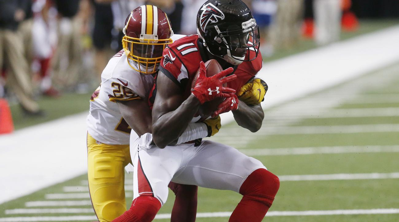 FILE - In this Aug. 11, 2016, file photo, Atlanta Falcons wide receiver Julio Jones (11) makes a catch against Washington Redskins cornerback Bashaud Breeland during a preseason NFL football game in Atlanta. Coach Dan Quinn expects All-Pro receiver Jones