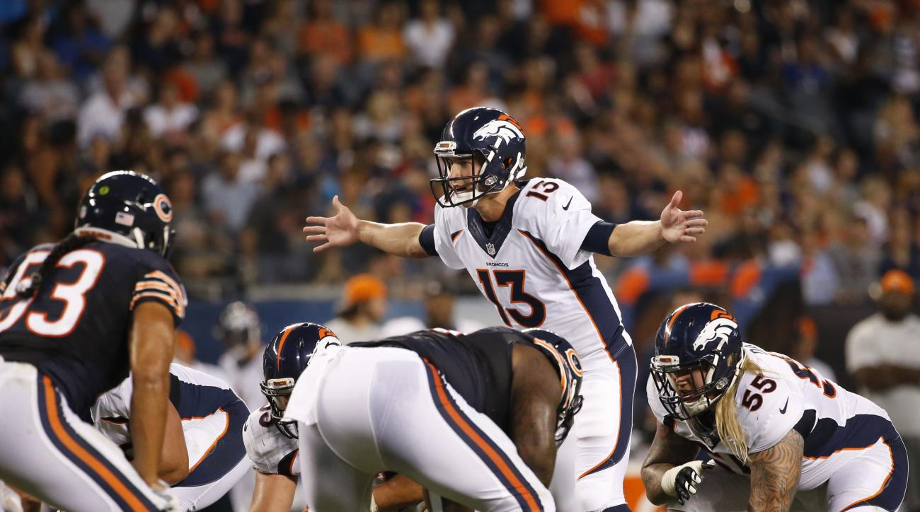 FILE - In this Aug. 11, 2016, file photo, Denver Broncos quarterback Trevor Siemian (13) calls a play at the line of scrimmage during the first half of an NFL preseason football game against the Chicago Bears in Chicago. The Carolina Panthers are out to r