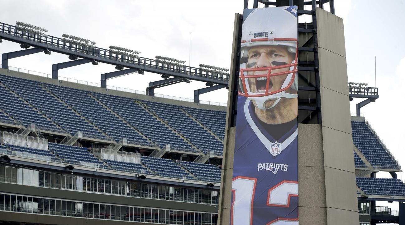 A oversized banner of New England Patriots' Tom Brady is attached to the lighthouse at an entrance to Gillette Stadium, Wednesday, Sept. 7, 2016, in Foxborough, Mass. (AP Photo/Steven Senne)