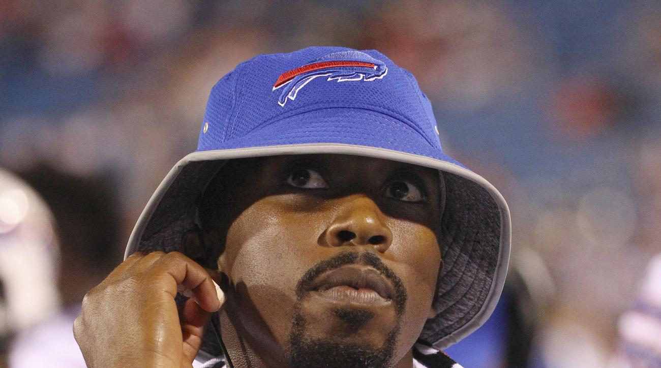 FILE - In this Aug. 13, 2016, file photo, Buffalo Bills quarterback Tyrod Taylor watches from the sideline during the second half of a preseason NFL football game against the Indianapolis Colts, in Orchard Park, N.Y. Taylor wasn't certain what lay in stor