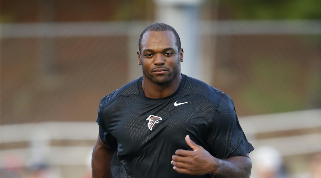 FILE - In this Aug. 5, 2016, file photo, Atlanta Falcons linebacker Dwight Freeney does some light running during their annual Friday Night Lights NFL football practice in Loganville, Ga. The Falcons hope Freeney, 36, can serve as a mentor to second-year