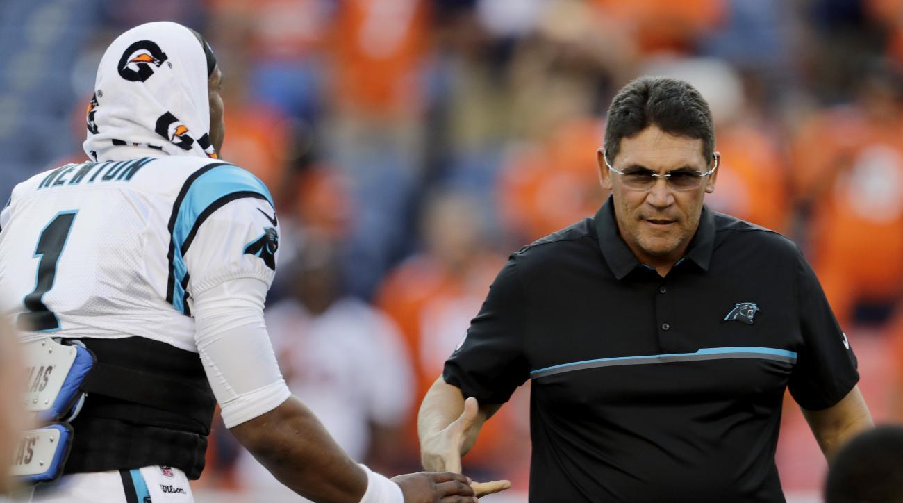 Carolina Panthers head coach Ron Rivera greets quarterback Cam Newton (1) prior to an NFL football game against the Denver Broncos , Thursday, Sept. 8, 2016, in Denver. (AP Photo/Joe Mahoney)