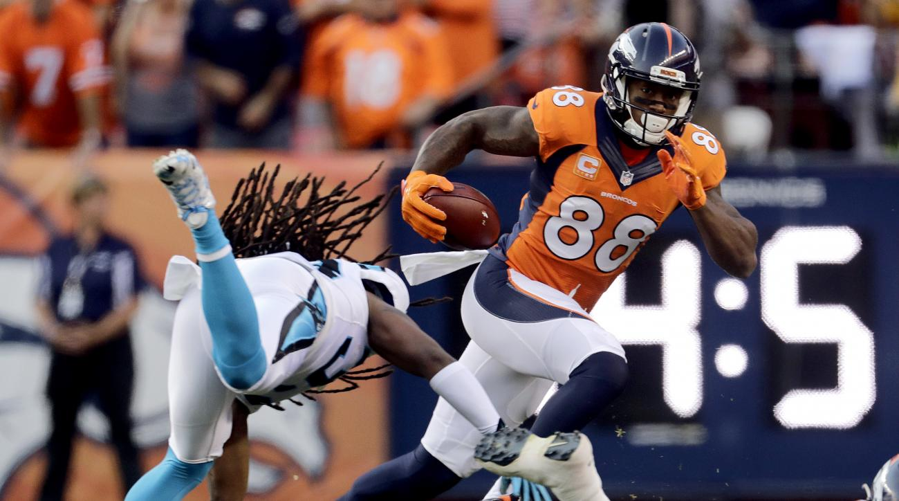 Denver Broncos wide receiver Demaryius Thomas (88) eludes the reach of Carolina Panthers free safety Tre Boston (33) during the first half of an NFL football game, Thursday, Sept. 8, 2016, in Denver. (AP Photo/Joe Mahoney)