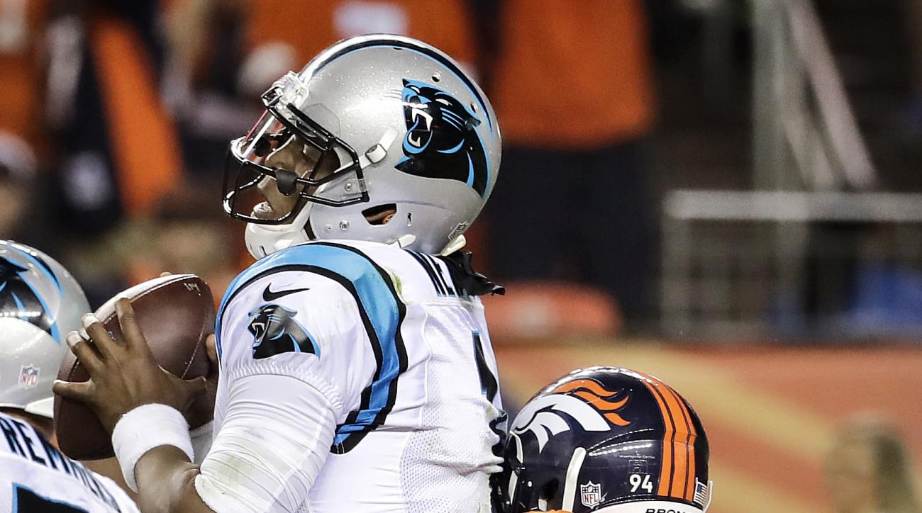 Carolina Panthers quarterback Cam Newton (1) is sacked by Denver Broncos outside linebacker DeMarcus Ware (94) during the second half of an NFL football game, Thursday, Sept. 8, 2016, in Denver. (AP Photo/Jack Dempsey)