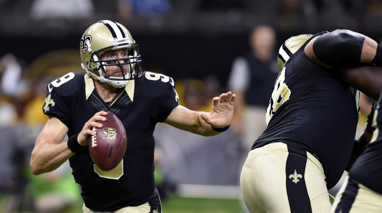 FILE - In this Sept. 1, 2016, file photo, New Orleans Saints quarterback Drew Brees (9) avoids the pass rush in the first half of a preseason NFL football game against the Baltimore Ravens in New Orleans. The Saints host the Oakland Raiders in the first g