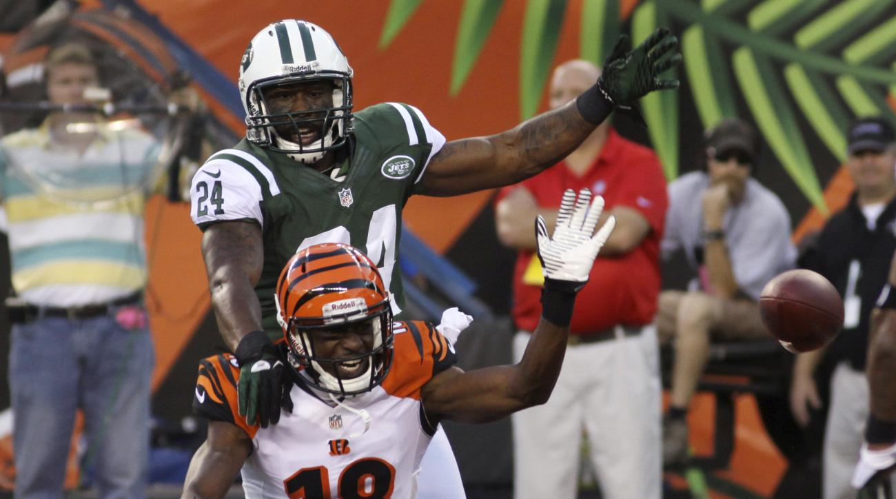 FILE - In this Aug. 10, 2012, file photo, New York Jets defensive back Darrelle Revis (24) knocks the ball loose from Cincinnati Bengals wide receiver A.J. Green  during the first half of an NFL preseason football game in Cincinnati. Green vs. Revis would