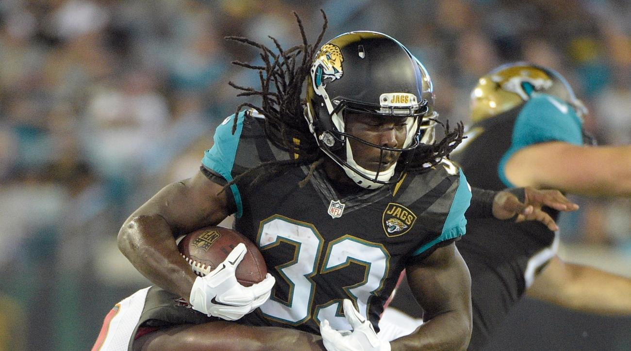 FILE - In this Aug. 20, 2016, file photo, Jacksonville Jaguars running back Chris Ivory (33) is stopped by the Tampa Bay Buccaneers defense after a short gain in the first half of an NFL preseason football game in Jacksonville, Fla. The Jaguars expect Ivo