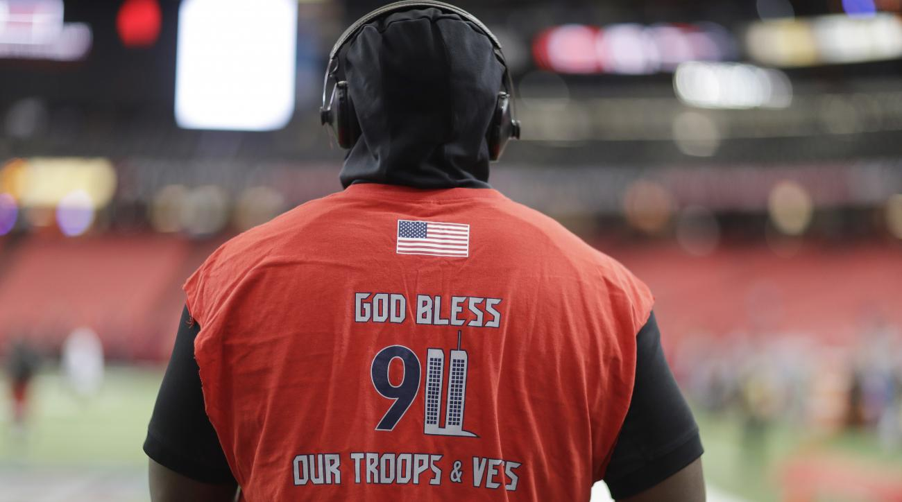 Tampa Bay Buccaneers defensive tackle Gerald McCoy warms up with a 9/11 remembrance shirt on before the first half of an NFL football game between the Atlanta Falcons and the Tampa Bay Buccaneers, Sunday, Sept. 11, 2016, in Atlanta. (AP Photo/David Goldma