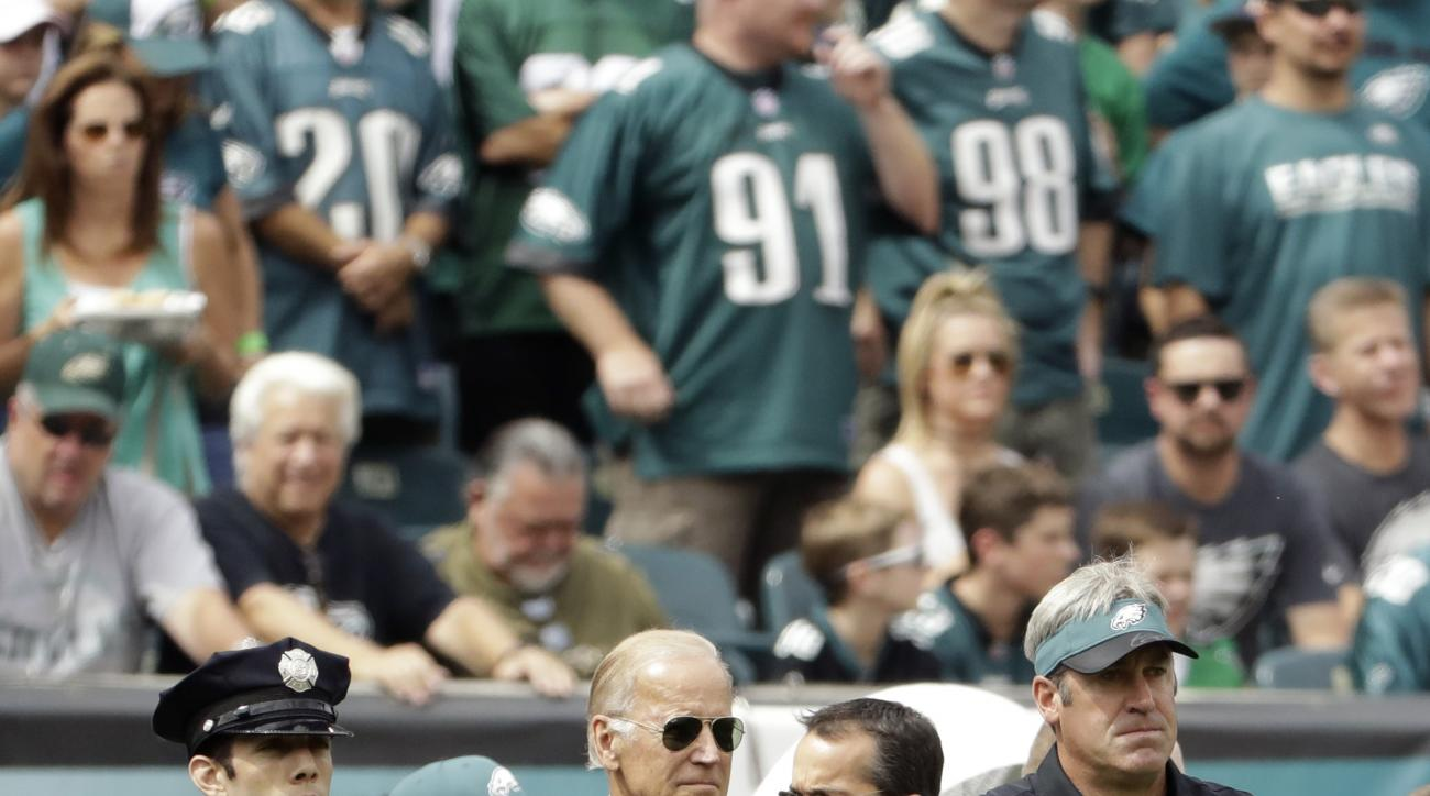 Vice President Joe Biden, center,  and Philadelphia Eagles head coach Doug Pederson, right,  stand before an NFL football game against the Cleveland Browns, Sunday, Sept. 11, 2016, in Philadelphia. (AP Photo/Matt Rourke)