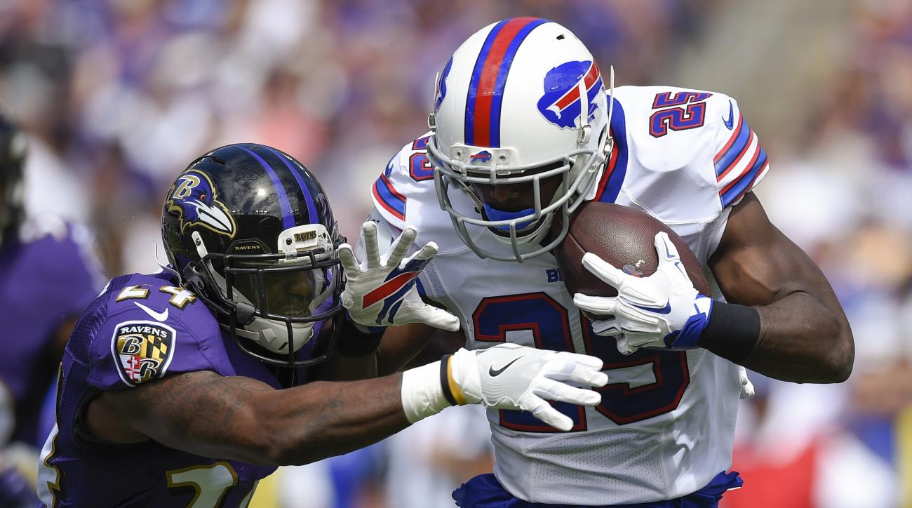 Buffalo Bills running back LeSean McCoy (25) is stopped by Baltimore Ravens cornerback Kyle Arrington (24) during the first half of an NFL football game in Baltimore, Sunday, Sept. 11, 2016. (AP Photo/Nick Wass)