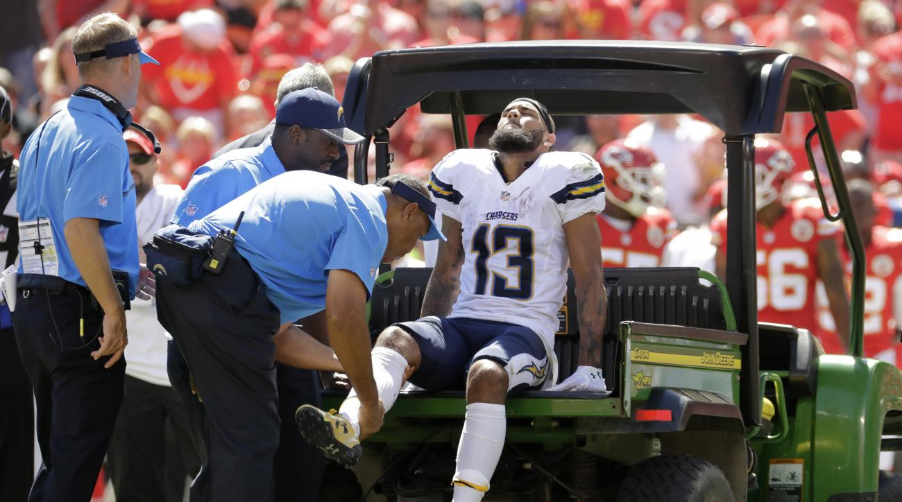 San Diego Chargers wide receiver Keenan Allen (13) is carted off the field during the first half of an NFL football game against the Kansas City Chiefs in Kansas City, Mo., Sunday, Sept. 11, 2016. (AP Photo/Charlie Riedel)