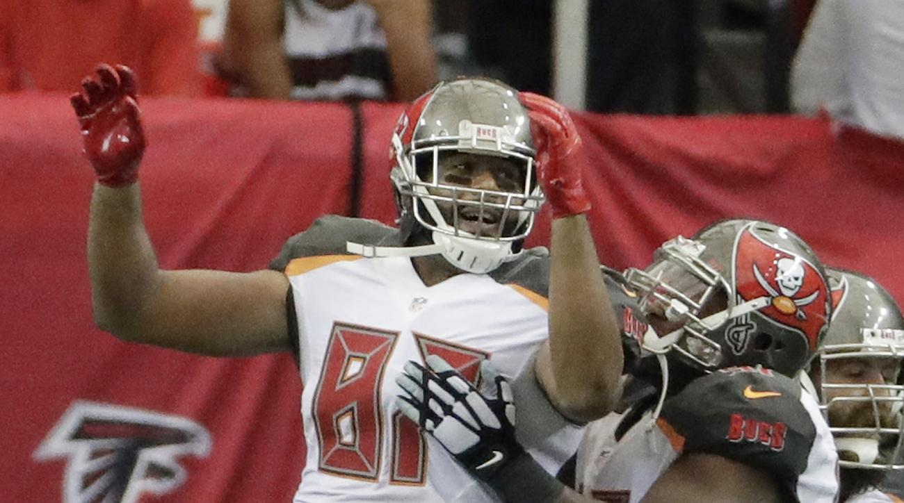 Tampa Bay Buccaneers tight end Austin Seferian-Jenkins (87) celebrates his touchdown against the Atlanta Falcons during the second half of an NFL football game, Sunday, Sept. 11, 2016, in Atlanta. (AP Photo/David Goldman)