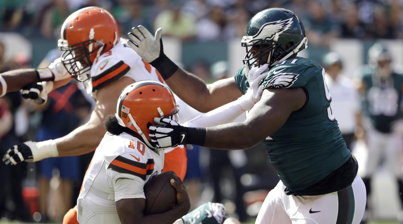 Philadelphia Eagles' Fletcher Cox, right, tackles Cleveland Browns' Robert Griffin III during the second half of an NFL football game against the Philadelphia Eagles, Sunday, Sept. 11, 2016, in Philadelphia. (AP Photo/Matt Rourke)