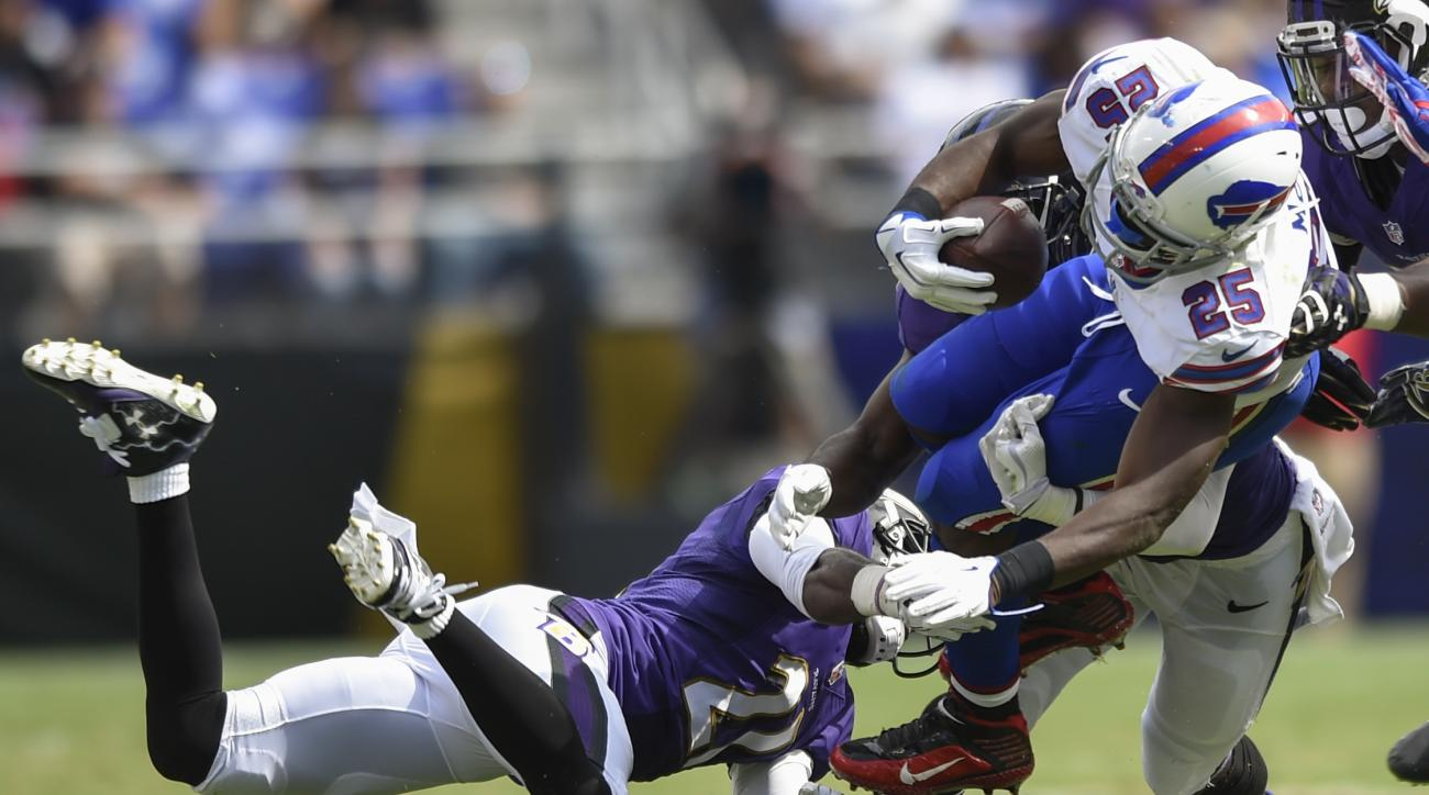 Buffalo Bills running back LeSean McCoy (25) is upended by Baltimore Ravens cornerback Lardarius Webb (21) during the second half of an NFL football game n Baltimore, Sunday, Sept. 11, 2016. (AP Photo/Gail Burton)