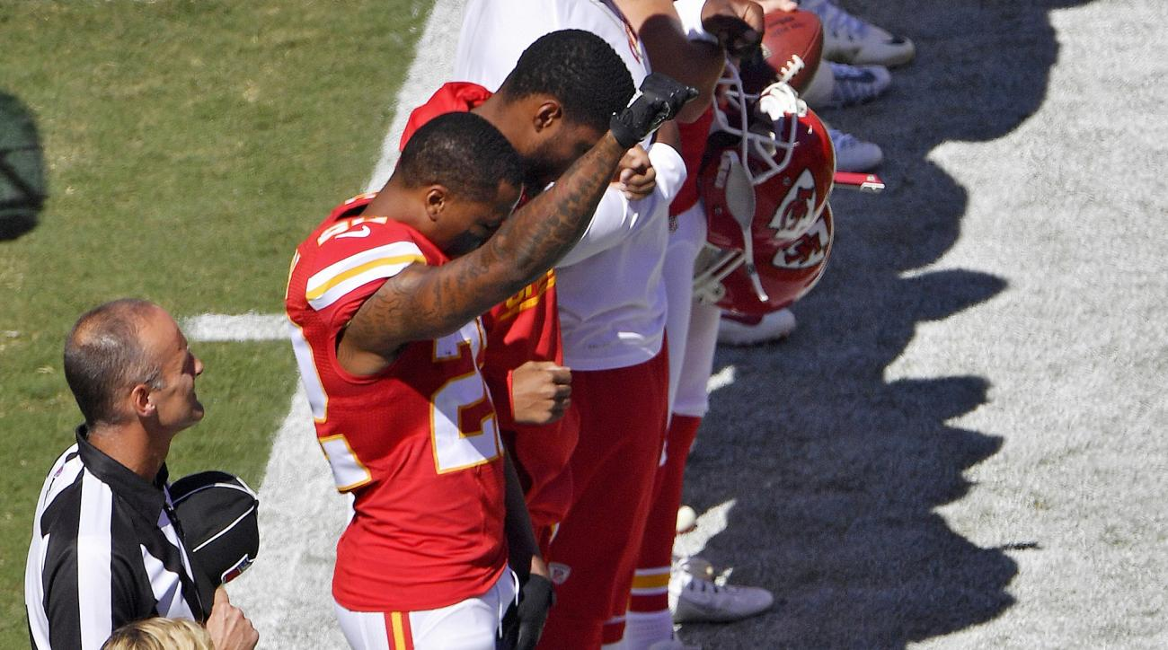 Kansas City Chiefs cornerback Marcus Peters raises his fist in the air during the national anthem before an NFL football game against the San Diego Chargers on Sunday, Sept. 11, 2016, in Kansas City, Mo. (John Sleezer/The Kansas City Star via AP)