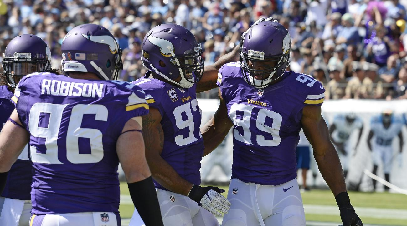 Minnesota Vikings defensive end Danielle Hunter (99) is congratulated by Everson Griffen (97) and Brian Robison (96) after Hunter recovered a fumble and returned it 24 yards for a touchdown against the Tennessee Titans in the second half of an NFL footbal