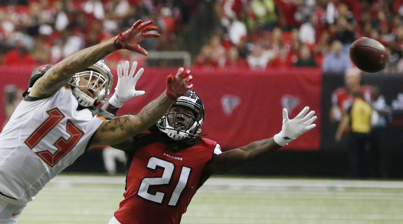Tampa Bay Buccaneers wide receiver Mike Evans (13) vies for a thrown ball as Atlanta Falcons cornerback Desmond Trufant (21) defends during the second half of an NFL football game, Sunday, Sept. 11, 2016, in Atlanta. (AP Photo/John Bazemore)