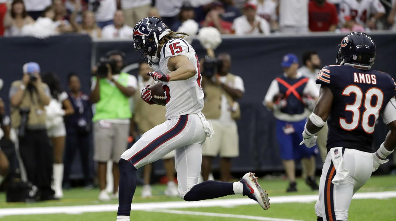 Houston Texans wide receiver Will Fuller (15) runs past Chicago Bears free safety Adrian Amos (38) to score a touchdown during the second half of an NFL football game Sunday, Sept. 11, 2016, in Houston. (AP Photo/David J. Phillip)