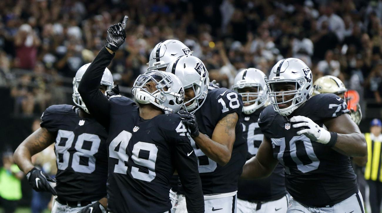 Oakland Raiders running back Jamize Olawale (49) reacts after scoring a touchdown in the second half of an NFL football game against the New Orleans Saints in New Orleans, Sunday, Sept. 11, 2016. (AP Photo/Bill Feig)