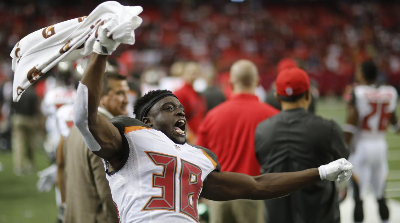 Tampa Bay Buccaneers cornerback Jude Adjei-Barimah (38) celebrates after an NFL football game against the Atlanta Falcons, Sunday, Sept. 11, 2016, in Atlanta. The Tampa Bay Buccaneers won 31-24. (AP Photo/David Goldman)