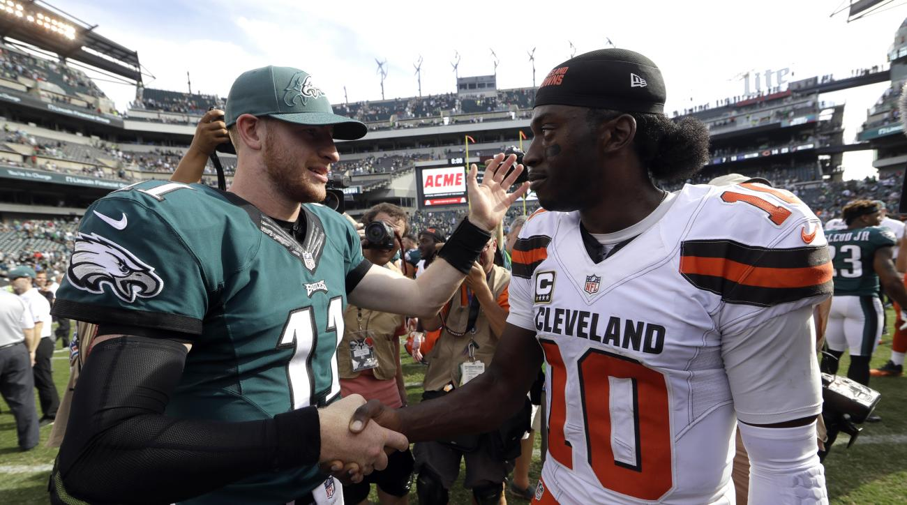 Philadelphia Eagles' Carson Wentz, left, and Cleveland Browns' Robert Griffin III meet after an NFL football game, Sunday, Sept. 11, 2016, in Philadelphia. (AP Photo/Matt Rourke)